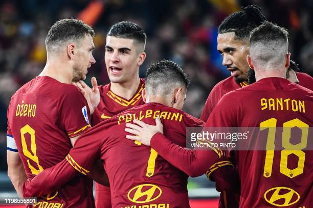 AS Roma's Bosnian forward Edin Dzeko celebrates with teammates after opening the scoring during the Italian Serie A football match Roma vs Lazio on...