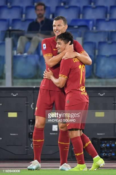 AS Roma's Bosnian forward Edin Dzeko congratulates AS Roma's Turkish forward Cengiz Under after he opened the scoring during the Italian Serie A...