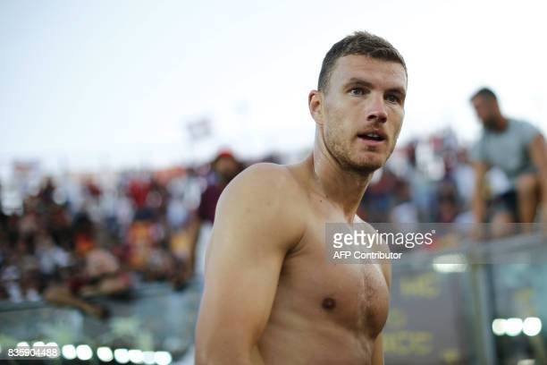 AS Roma's Bosnian forward Edin Dzeko looks on at the end of the Italian Serie A football match between Atalanta and AS Roma on August 20 2017 at the...