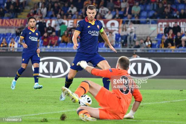 Roma's Bosnian forward Edin Dzeko prepares to shoot and score a goal during the UEFA Europa League Group J football match AS Roma vs Istanbul...