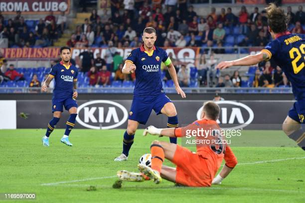 Roma's Bosnian forward Edin Dzeko prepares to shoot and score his team's second goal during the UEFA Europa League Group J football match AS Roma vs...
