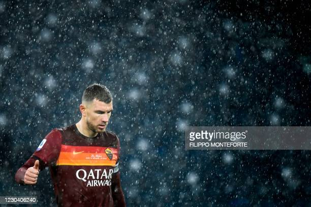 Roma's Bosnian forward Edin Dzeko reacts during the Italian Serie A football match AS Rome vs Sampdoria on January 3, 2021 at the Olympic stadium in...