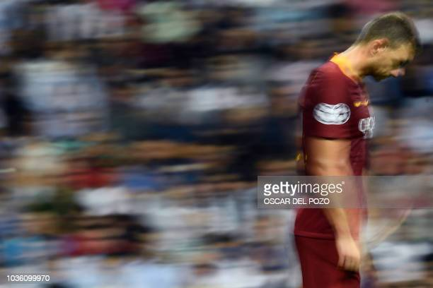Roma's Bosnian forward Edin Dzeko reacts to Real Madrid's third goal during the UEFA Champions League group G football match between Real Madrid CF...