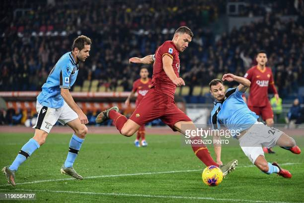 Roma's Bosnian forward Edin Dzeko shoots on goal during the Italian Serie A football match Roma vs Lazio on January 26 2020 at the Olympic stadium in...