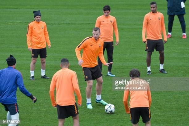 Roma's Bosnian forward Edin Dzeko takes part in a training session a day before the Champions League quarterfinal secondleg football match AS Roma vs...