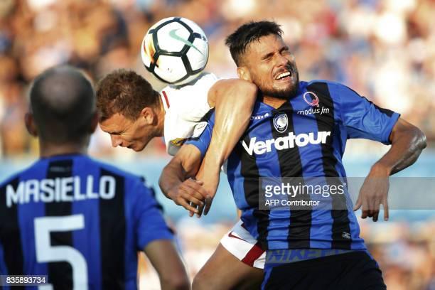 Roma's Bosnian forward Edin Dzeko vies with Atalanta's Bosnian defender Ervin Zukanovic during the Italian Serie A football match between Atalanta...