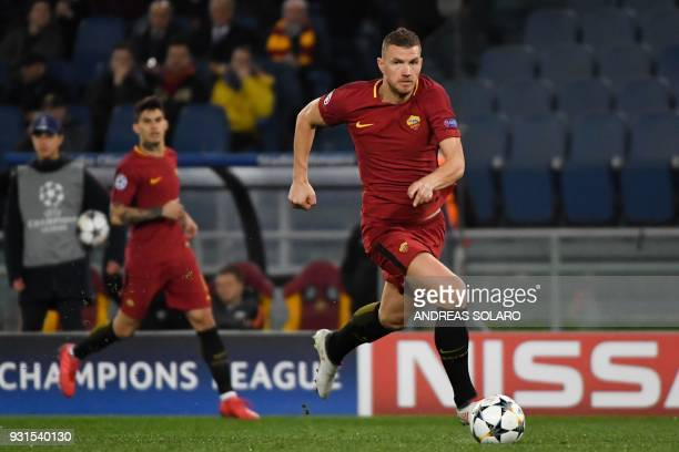 Roma's Bosnian striker Edin Dzeko controls the ball during the UEFA Champions League round of 16 second leg football match AS Roma vs Shakhtar...