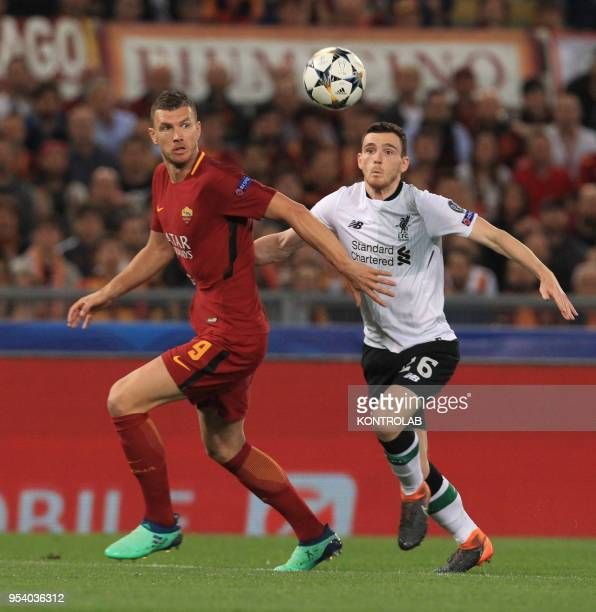 Roma's Bosnian striker Edin Dzeko fights for the ball with Liverpool's Scottish defender Andrew Robertson during the UEFA Champions League semifinal...