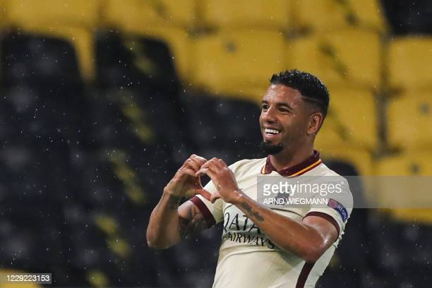 Roma's Brazilian defender Bruno Peres celebrates after scoring a goal during the UEFA Europa League Group A first-leg football match between Young...
