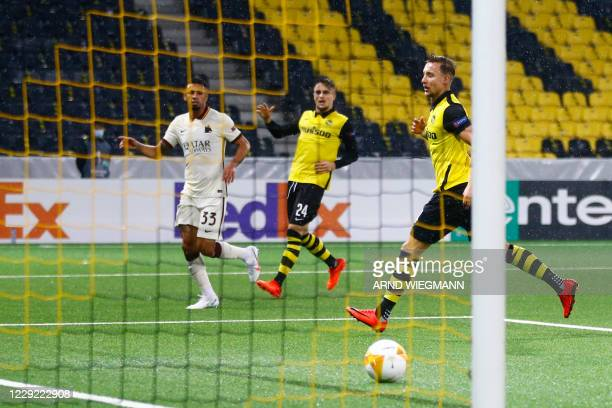 Roma's Brazilian defender Bruno Peres shoots and scores a goal during the UEFA Europa League Group A first-leg football match between Young Boys and...