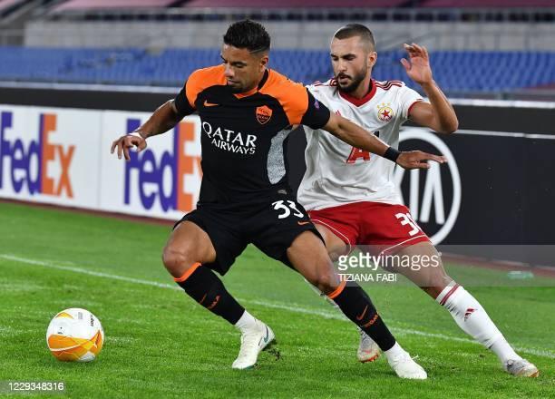 Roma's Brazilian defender Bruno Peres vies for the ball with CSKA Sofia's Bulgarian midfielder Georgi Yomov during the UEFA Europa League Group A...