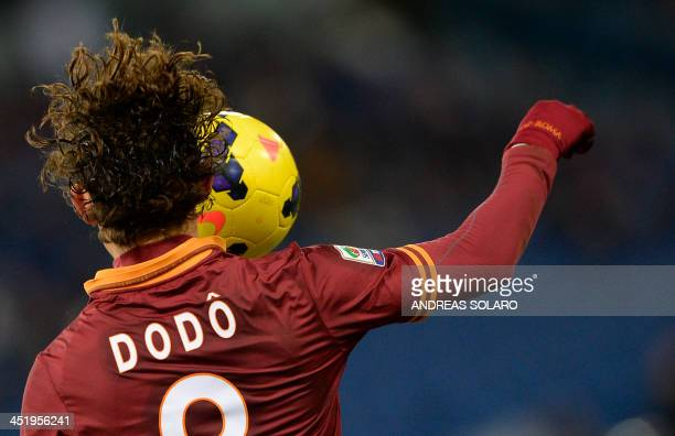 AS Roma's Brazilian defender Dodo jumps for the ball during the Italian Serie A football match AS Roma vs Cagliari on November 25 2013 at Rome's...