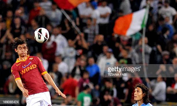 AS Roma's Brazilian defender Dodo jumps for the ball with SSC Napoli's Uruguayan striker Edinson Cavani during the Italian Serie A football match AS...