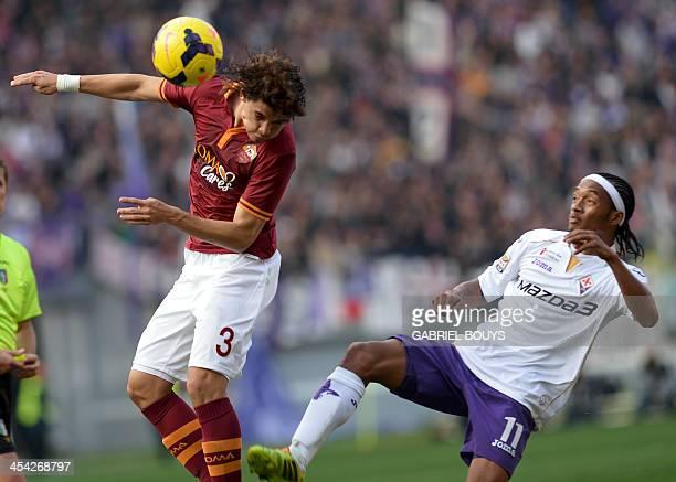AS Roma's Brazilian defender Dodo vies with Fiorentina's Colombian midfielder Bello Juan Guillermo Cuadrado during the Italian Serie A football match...