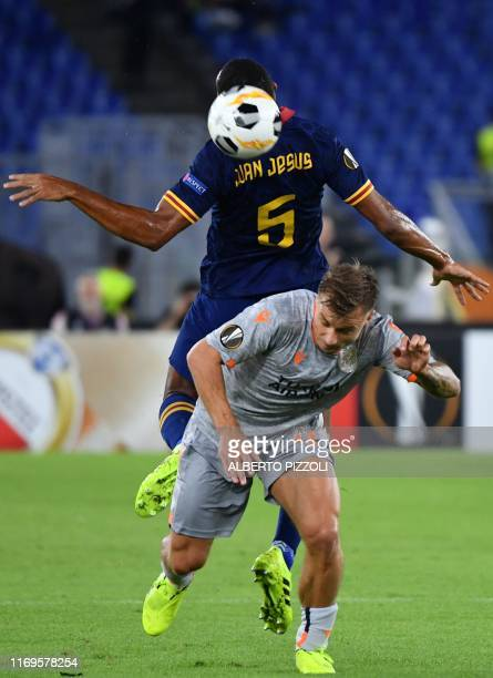 Roma's Brazilian defender Juan Jesus and Istanbul Basaksehir FK's Turkish midfielder Mehmet Topal go for a header the UEFA Europa League Group J...