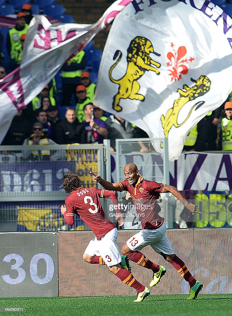AS Roma's Brazilian defender Maicon (R) celebrates his goal during the Italian Serie A football match between AS Roma and Fiorentina on December 8, 2013 at the Olympic stadium in Rome.