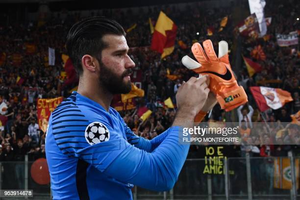 Roma's Brazilian goalkeeper Alisson acknowledges fans at the end of the UEFA Champions League semifinal second leg football match between AS Roma and...