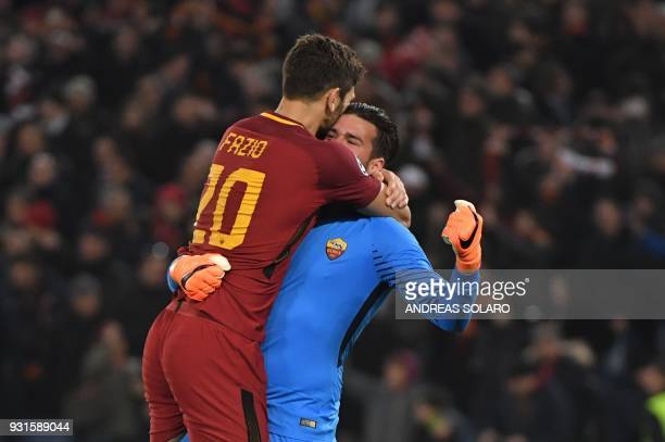 TOPSHOT Roma's Brazilian goalkeeper Alisson and Roma's Argentinian defender Federico Fazio celebrate afer winning 10 the UEFA Champions League round...