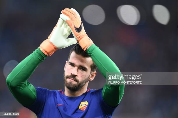 AS Roma's Brazilian goalkeeper Alisson Becker gestures ahead of the UEFA Champions League quarterfinal second leg football match between AS Roma and...