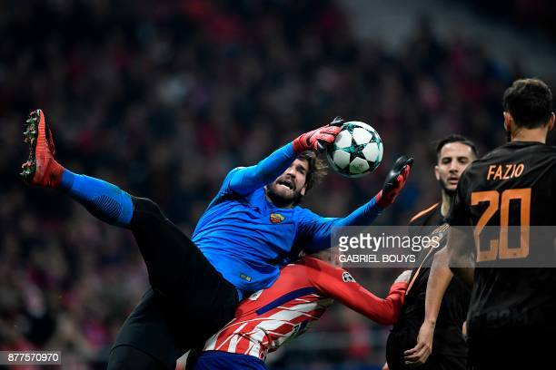 Roma's Brazilian goalkeeper Alisson blocks a shot on goal by Atletico Madrid's Uruguayan defender Jose Gimenez during the UEFA Champions League group...