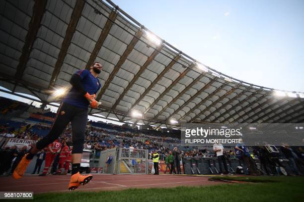 Roma's Brazilian goalkeeper Alisson enters the pitch before the Italian Serie A football match AS Roma vs Juventus at the Olympic stadium on May 13...