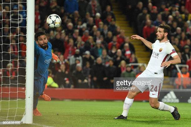 Roma's Brazilian goalkeeper Alisson fails to stop a goal by Liverpool's Brazilian midfielder Roberto Firmino during the UEFA Champions League first...