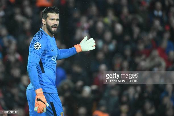 Roma's Brazilian goalkeeper Alisson gestures during the UEFA Champions League first leg semifinal football match between Liverpool and Roma at...