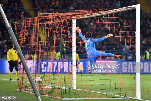 Roma's Brazilian goalkeeper Alisson jumps but misses the goal scored by Shakhtar Donetsk's midfielder Fred during the UEFA Champions League round of...