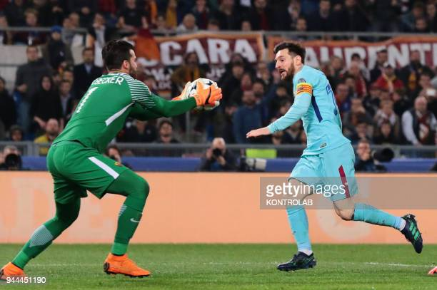 Roma's Brazilian goalkeeper Alisson keep the ball in front of Barcelona's Argentinian striker Lionel Messi during the UEFA Champions League...