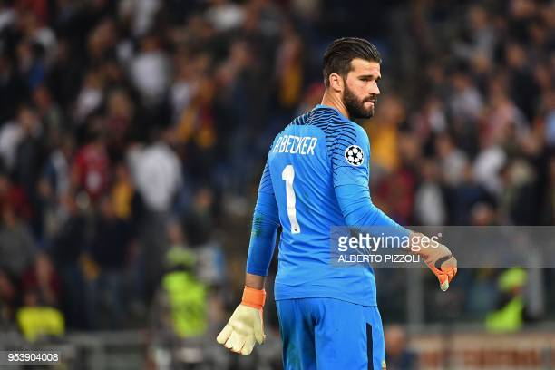 Roma's Brazilian goalkeeper Alisson looks on after being defeated by Liverpool at the end of the UEFA Champions League semifinal second leg football...