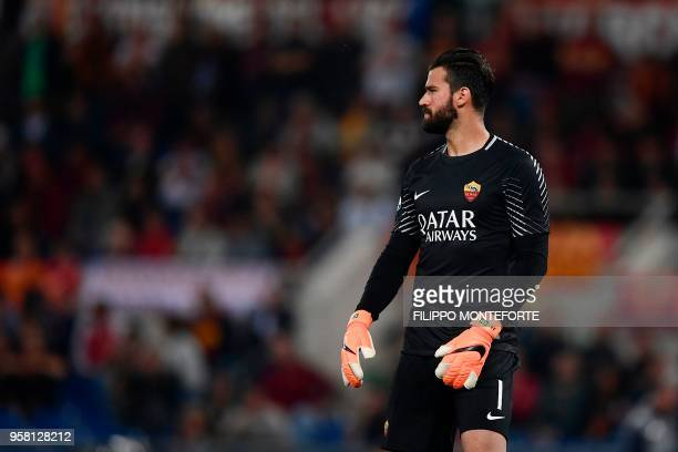 Roma's Brazilian goalkeeper Alisson looks on before the Italian Serie A football match AS Roma vs Juventus at the Olympic stadium on May 13 2018 in...