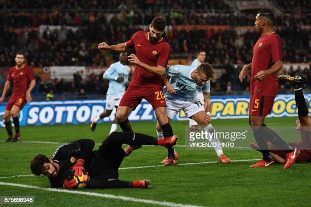 Roma's Brazilian goalkeeper Alisson makes a save during the Italian Serie A football match AS Roma vs Lazio on November 18 2017 at the Olympic...