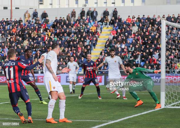 Roma's Brazilian goalkeeper Alisson makes a save during the Italian Serie A football match FC Crotone vs AS Roma on March 18 2018 at the Ezio Scida...