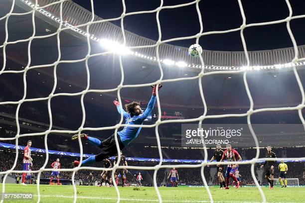 Roma's Brazilian goalkeeper Alisson punches the ball away during the UEFA Champions League group C football match between Atletico Madrid and AS Roma...