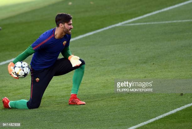 Roma's Brazilian goalkeeper Alisson Ramses Becker attends a training session at the Camp Nou Stadium on April 3 2018 on the eve of the UEFA Champions...