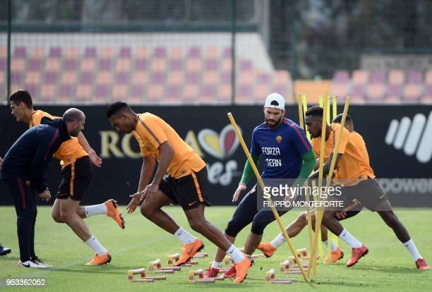 Roma's Brazilian goalkeeper Alisson Ramses Becker attends a training session at Roma training ground in Trigoria on May 1 a day before their...