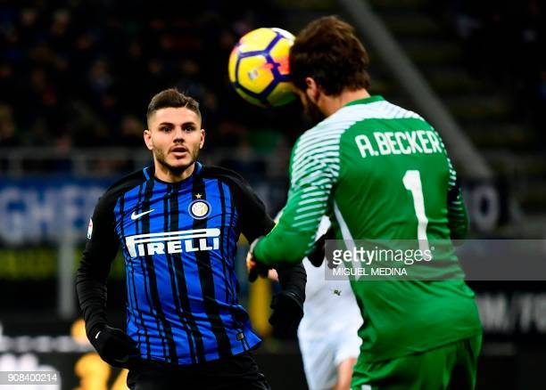 Roma's Brazilian goalkeeper Alisson Ramses Becker heads the ball as Inter Milan's Captain Argentinian forward Mauro Icardi looks on during the...