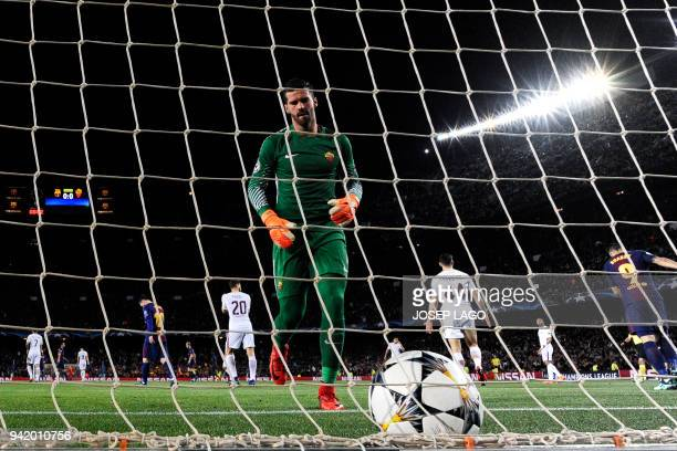 Roma's Brazilian goalkeeper Alisson reacts after his team scored an own goal during the UEFA Champions League quarterfinal first leg football match...