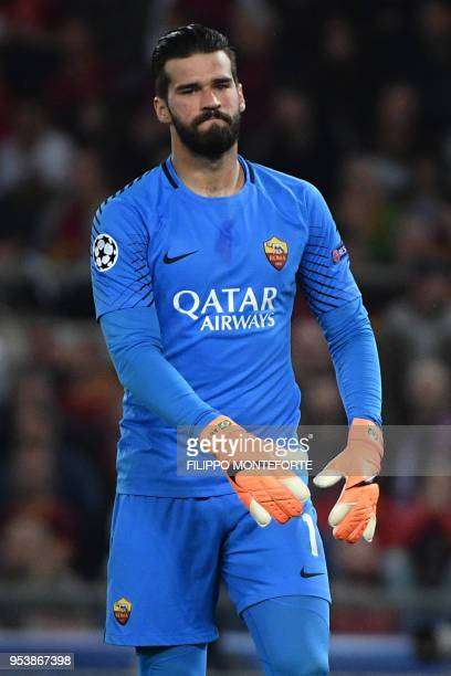 Roma's Brazilian goalkeeper Alisson reacts after Liverpool scored a goal during the UEFA Champions League semifinal second leg football match between...