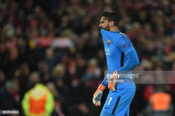Roma's Brazilian goalkeeper Alisson reacts after Liverpool scored their third goal during the UEFA Champions League first leg semifinal football...