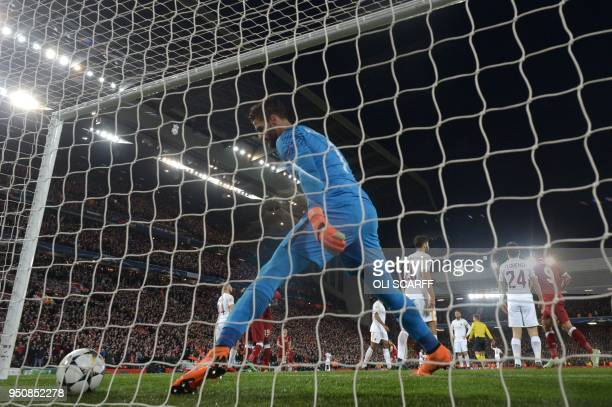 Roma's Brazilian goalkeeper Alisson retrieves the ball after Liverpool score their third goal during the UEFA Champions League first leg semifinal...