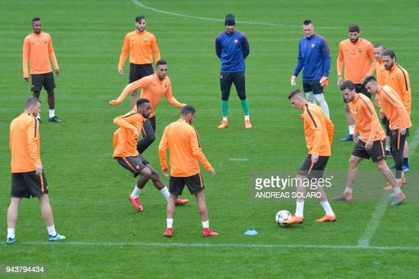 Roma's Brazilian goalkeeper Alisson takes part in a training session a day before the Champions League quarterfinal secondleg football match AS Roma...