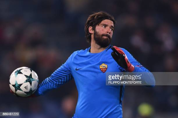 Roma's Brazilian goalkeeper Alisson throws the ball during the UEFA Champions League Group C football match AS Roma vs FK Qarabag on December 5 2017...