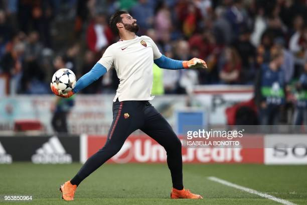Roma's Brazilian goalkeeper Alisson warms up ahead of the UEFA Champions League semifinal second leg football match between AS Roma and Liverpool at...