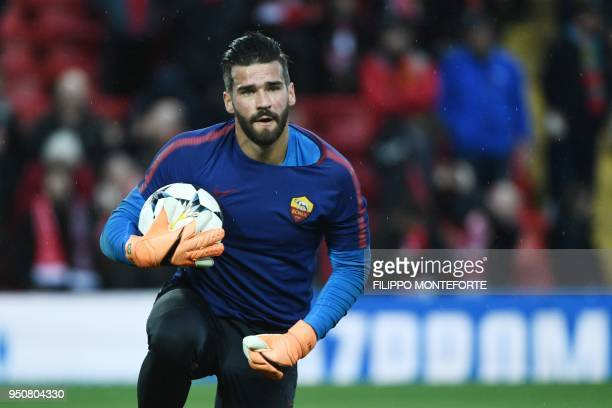 Roma's Brazilian goalkeeper Alisson warms up before the UEFA Champions League first leg semifinal football match between Liverpool and Roma at...