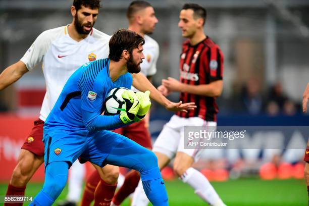 AS Roma's Brazilian goalkeeper Allison Becker controls the ball during the Italian Serie A football match AC Milan vs AS Roma at the San Siro stadium...