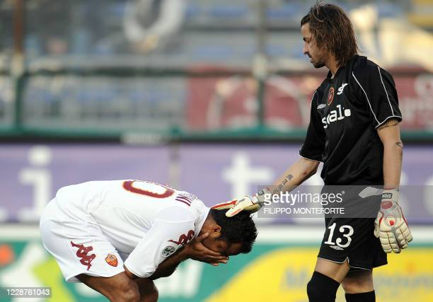 Roma's Brazilian midfielder Alessandro Mancini is conforted by Cagliari's goalkeeper Marco Storaro during their Italian serie A football match i at...