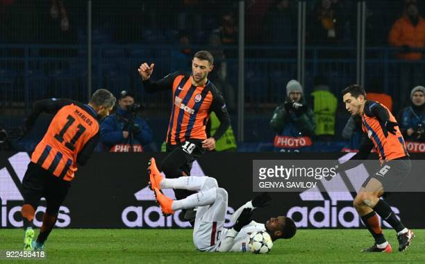 Roma's Brazilian midfielder Gerson fights for the ball with Shakhtar Donetsk's midfielder Marlos Shakhtar Donetsk's defender Ivan Ordets and Shakhtar...