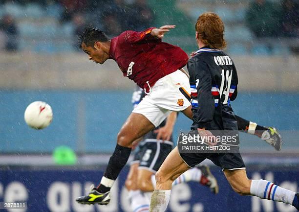 Roma's Brazilian midfielder Mancini vies with Sampdoria Genoa's defender Mirko Conte during their italian Serie A soccer match at the Olympic stadium...