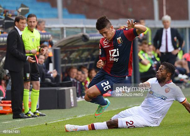 AS Roma's Brazilian midfielder Michel Fernandes Bastos takles Genoa's forward Adrian Ricardo Centurion of Argentina in front of AS Roma's French...
